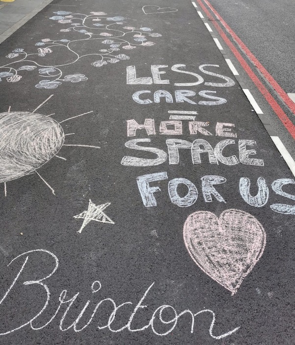Brixton High Road pavement decorated with chalk by Lambeth Living Streets  Yes, should read fewer cars.  Bugs us too.